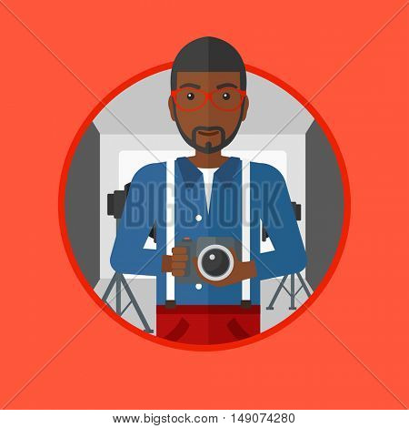 An african-american photographer holding a camera in photo studio. Photographer using professional camera in the studio. Vector flat design illustration in the circle isolated on background.