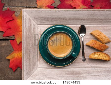 Cup of espresso with cantuccini on a wooden table