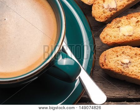 Closeup of Cantuccini with a cup of espresso on a wooden table