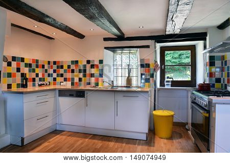 French kitchen interior with colorful tiles