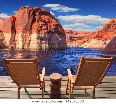 Walk to the tourist boat on Lake Powell on the Colorado River. At the stern of the vessel are two deck chairs