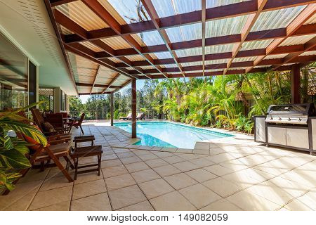 Alfresco backyard dining table with smiming pool