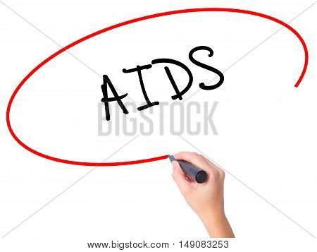 Women Hand Writing Aids With Black Marker On Visual Screen