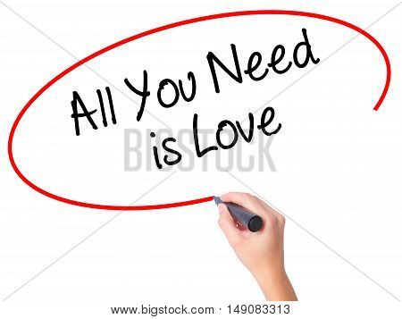Women Hand Writing All You Need Is Love With Black Marker On Visual Screen