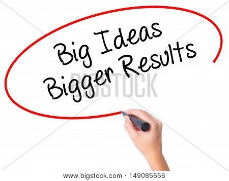 Women Hand Writing Big Ideas Bigger Results  With Black Marker On Visual Screen