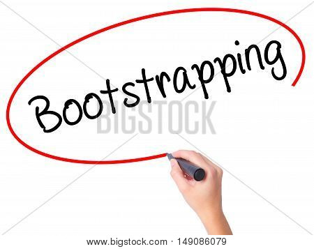 Women Hand Writing Bootstrapping With Black Marker On Visual Screen