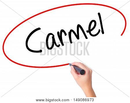 Women Hand Writing Carmel With Black Marker On Visual Screen