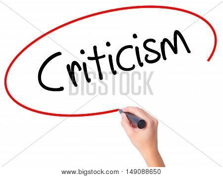 Women Hand Writing Criticism With Black Marker On Visual Screen