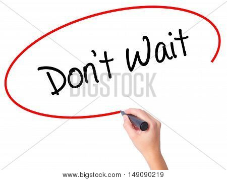 Women Hand Writing Don't Wait  With Black Marker On Visual Screen
