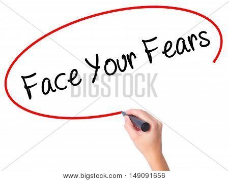 Women Hand Writing Face Your Fears With Black Marker On Visual Screen