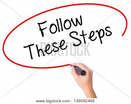 Women Hand Writing Follow These Steps With Black Marker On Visual Screen