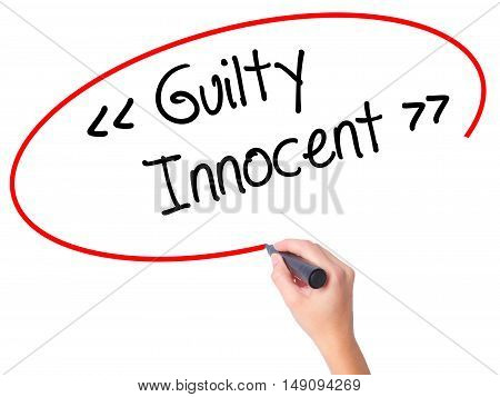 Women Hand Writing Guilty - Innocent With Black Marker On Visual Screen.