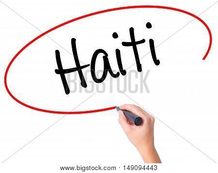 Women Hand Writing Haiti With Black Marker On Visual Screen