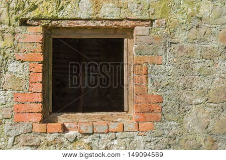 architectural background of a glassless brick surround window frame