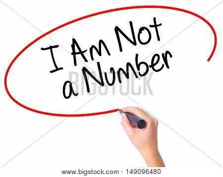 Women Hand Writing I Am Not A Number With Black Marker On Visual Screen