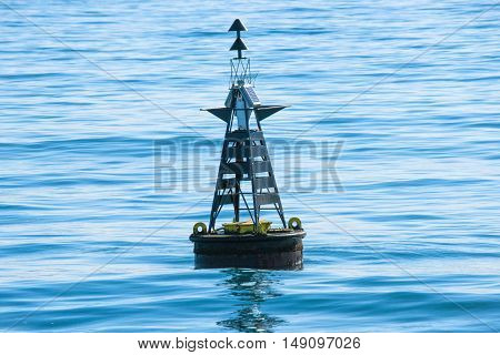 Large buoy marker in the cold blue sea