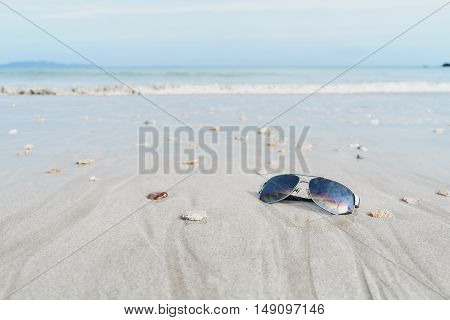 glasses on the tropical beach with white sand Travel relax vacation