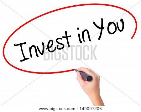 Women Hand Writing  Invest In You With Black Marker On Visual Screen