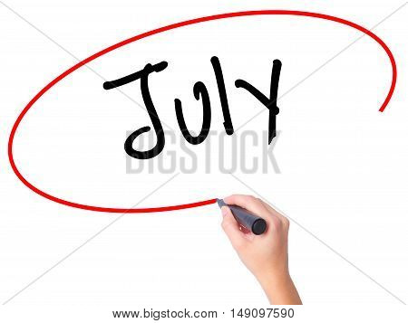 Women Hand Writing July With Black Marker On Visual Screen