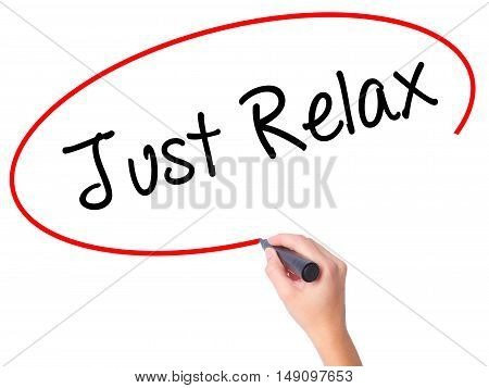 Women Hand Writing Just Relax With Black Marker On Visual Screen
