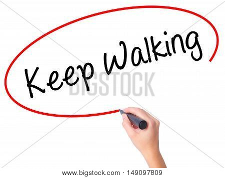 Women Hand Writing Keep Walking With Black Marker On Visual Screen