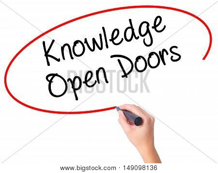 Women Hand Writing  Knowledge Open Doors  With Black Marker On Visual Screen