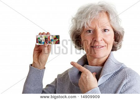 Old Woman Showing Pill Dispenser