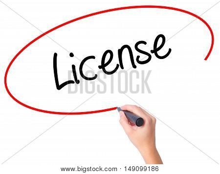 Women Hand Writing License With Black Marker On Visual Screen
