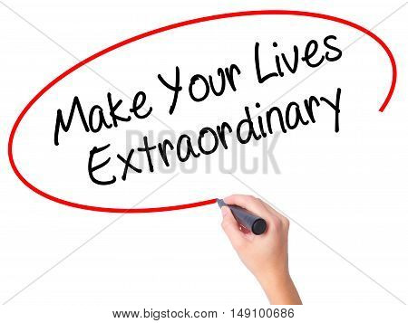 Women Hand Writing Make Your Lives Extraordinary With Black Marker On Visual Screen
