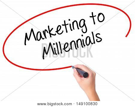 Women Hand Writing Marketing To Millennials With Black Marker On Visual Screen