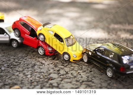 Close up of toy cars crash