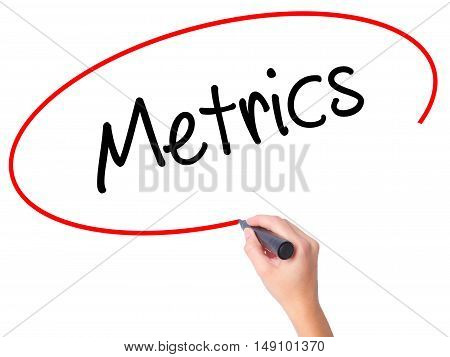 Women Hand Writing  Metrics  With Black Marker On Visual Screen