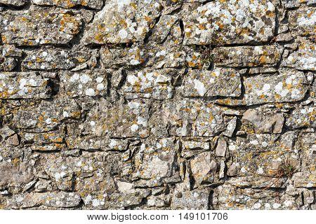 Background from a rough wall of natural stone