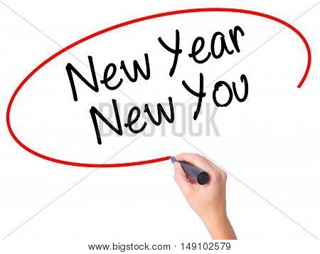 Women Hand Writing New Year New You With Black Marker On Visual Screen