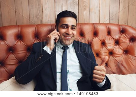 Businessman with thumb up hand sign, free space. Successful business problems solving. Feeling like, satisfaction concept.
