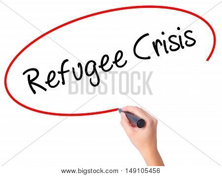 Women Hand Writing Refugee Crisis With Black Marker On Visual Screen