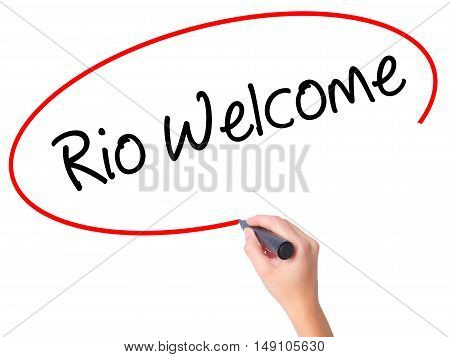Women Hand Writing Rio Welcome With Black Marker On Visual Screen.