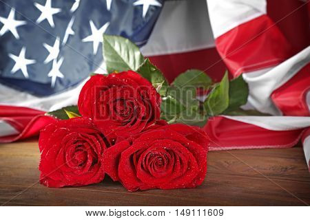 Red roses and American flag, closeup