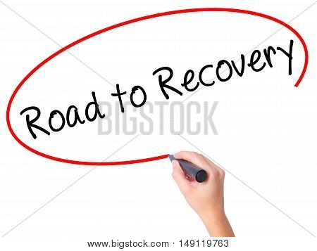 Women Hand Writing Road To Recovery With Black Marker On Visual Screen