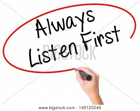 Women Hand Writing Always Listen First With Black Marker On Visual Screen