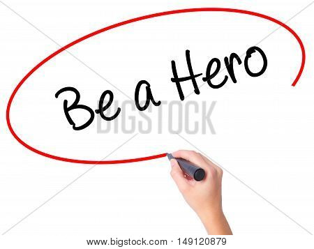 Women Hand Writing Be A Hero  With Black Marker On Visual Screen