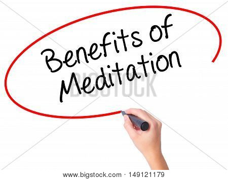 Women Hand Writing Benefits Of Meditation With Black Marker On Visual Screen.