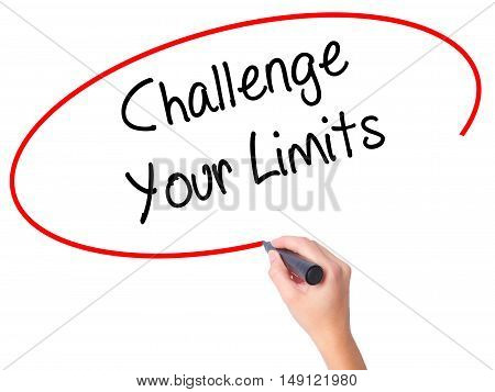 Women Hand Writing Challenge Your Limits With Black Marker On Visual Screen