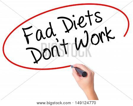 Women Hand Writing Fad Diets Don't Work With Black Marker On Visual Screen