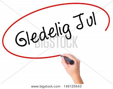 Women Hand Writing Gledelig Jul  (happy Christmas In Norwegian) With Black Marker On Visual Screen
