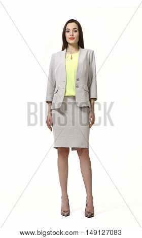 indian business woman with straight hair style in official gray skirt suit high heel shoes full body length isolated on white
