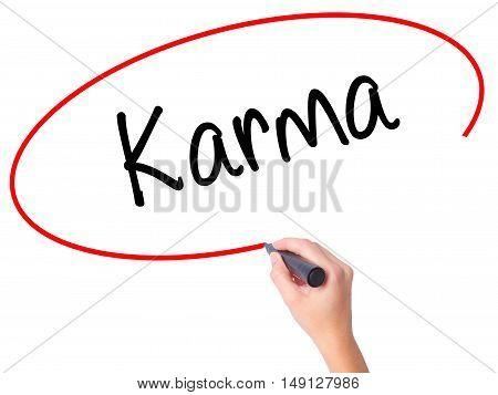 Women Hand Writing Karma  With Black Marker On Visual Screen