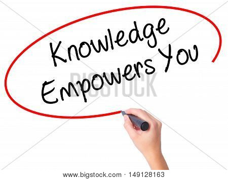 Women Hand Writing Knowledge Empowers You With Black Marker On Visual Screen