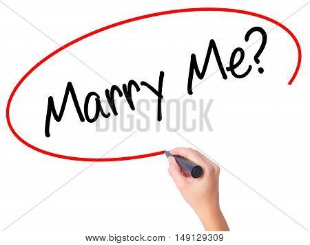 Women Hand Writing Marry Me? With Black Marker On Visual Screen.