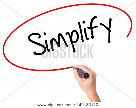 Women Hand Writing Simplify With Black Marker On Visual Screen
